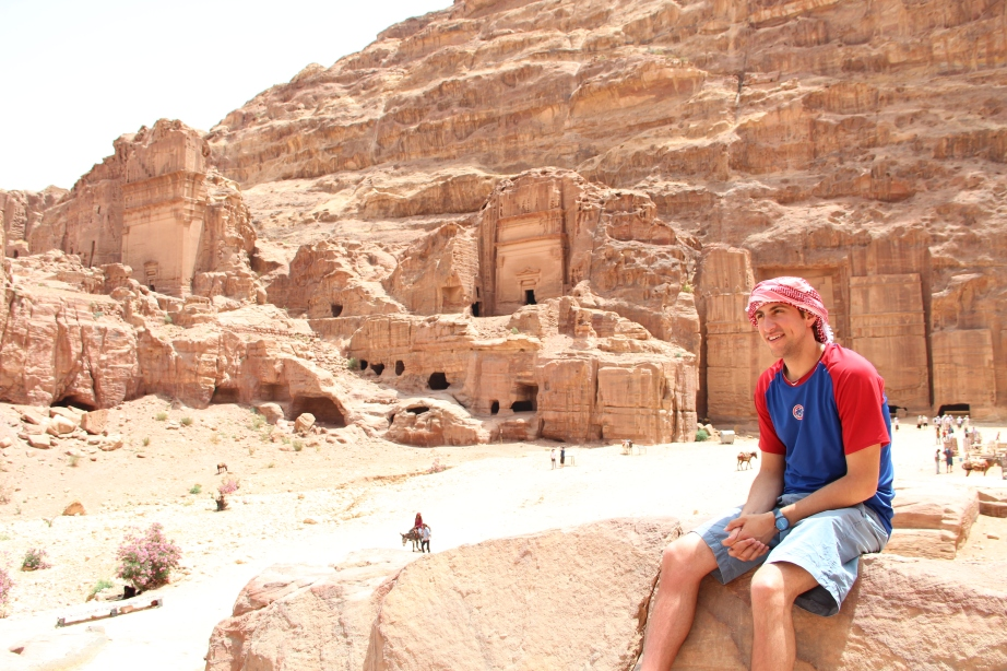 Keffiyeh + red desert cliffs = realness. He's the next Indiana Jones.