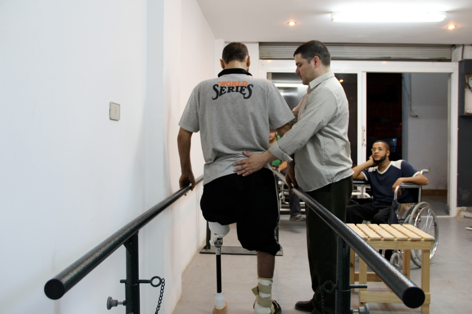 Syrian refugee Shadi stands for the first time in six months. He lost his entire left leg because of tank gunfire.