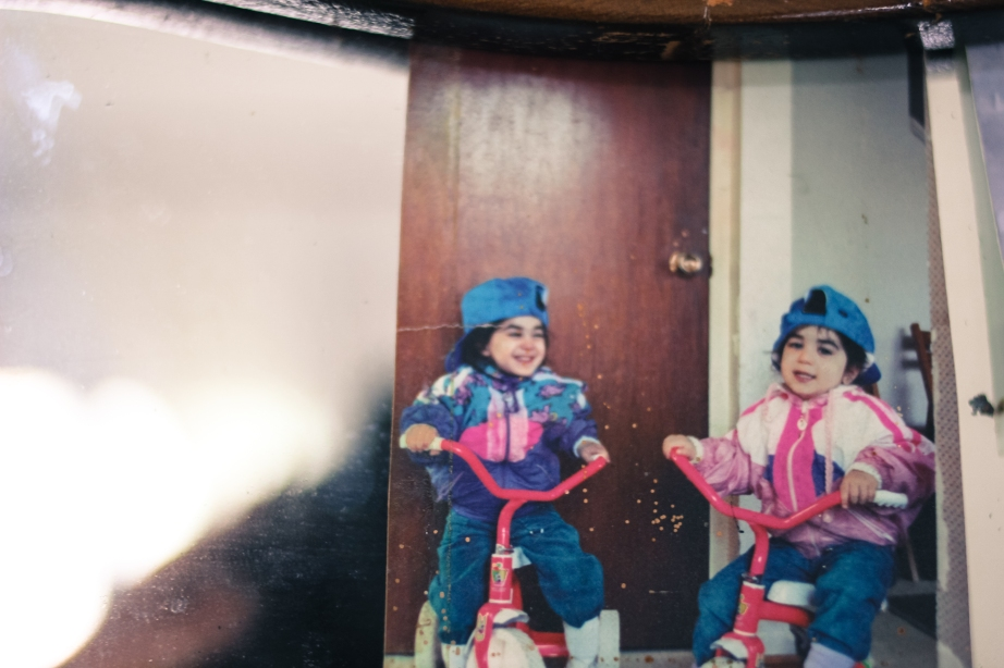 Grandparents' house = very old pictures. My twin sister and I, looking fresh on our tricycles.
