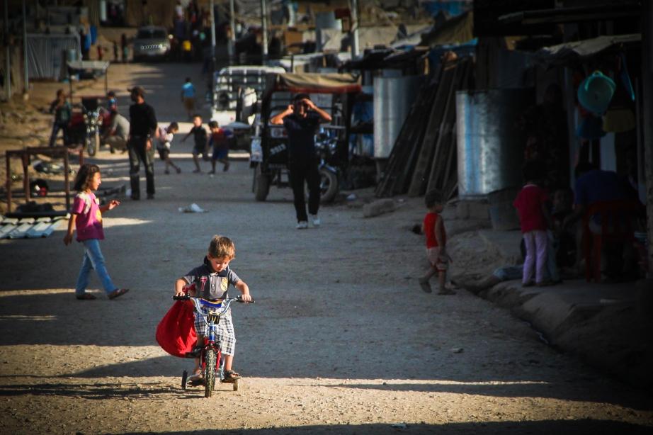 The triumph of childhood. Domiz camp, Iraqi Kurdistan.