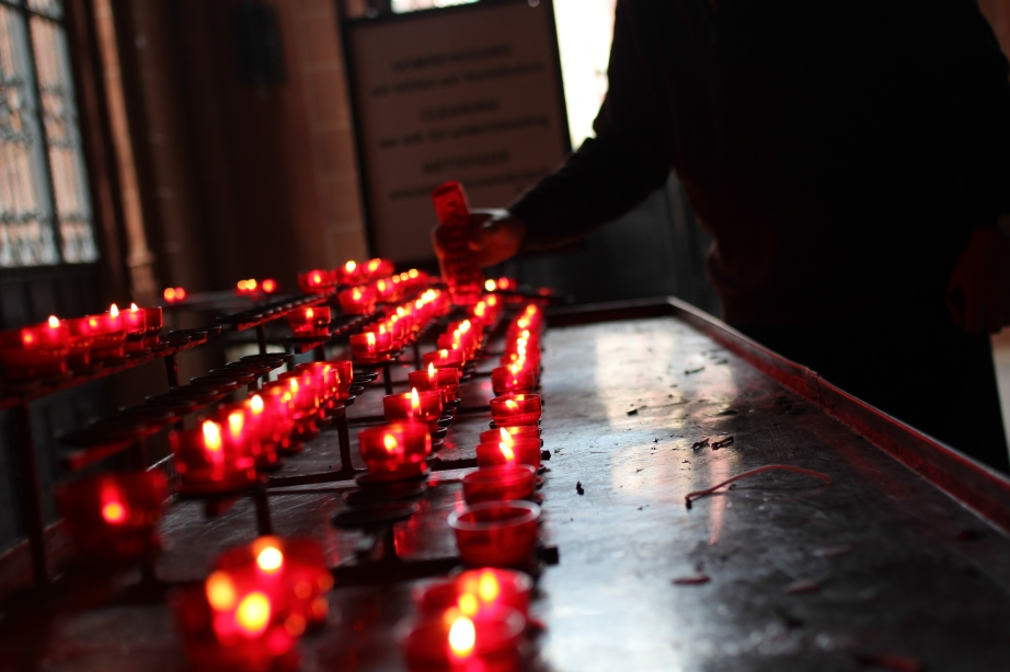 Lighting candles for our loved ones.